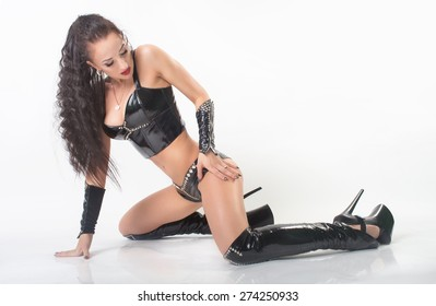 attractive sexy girl posing in fetish wear. More outfits in photo set