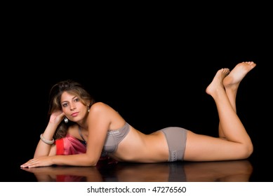Attractive sexy  woman in lingerie and red bathrobe.  Studio shot, black background.