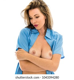 Attractive Sexy Woman Posing Topless In An Open Blue Shirt Isolated Against A White Background
