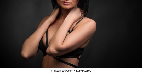 Attractive sexy young girl in swordbelt and bra with big breast