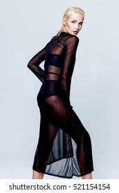 Attractive sexy young woman in black underwear