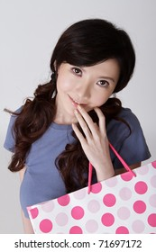 Attractive shopping woman of Chinese, closeup portrait with smiling face.