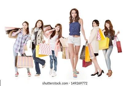 Attractive shopping women walk and look at you, group full length portrait isolated on white background.
