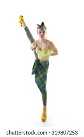 Attractive slim teen girl posing in studio. Full length portrait of young fashion woman. Fitness dancing girl.