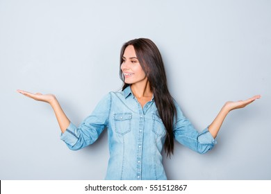 Attractive smiling brunette woman showing balance with hands