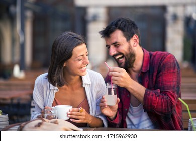 Attractive smiling couple drinking coffee and have fun