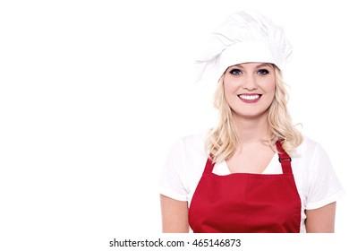 Attractive smiling female in chef uniform and toque