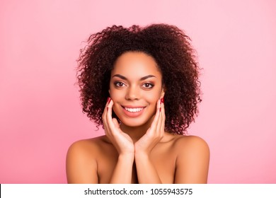 Attractive, smiling, happy, joyful brunette, sensual,  naked girl touching her perfect face skin with fingers, looking at camera, isolated on pink background, moisturizing, hydration, aging concept