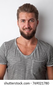 Attractive smiling man with a beard