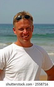 Attractive smiling man on the beach
