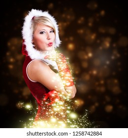 attractive smiling miss santa with christmas magic in front of christmas background
