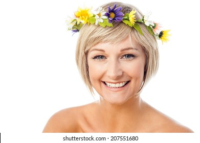 Attractive smiling woman with flower wreath on head