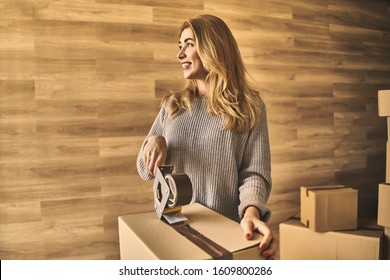 Attractive smiling woman getting ready to move into new house