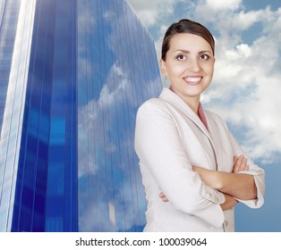 Attractive smiling woman on the bright blue business building and sky background