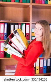 attractive smiling woman with stack of folders