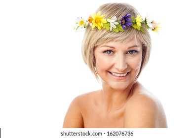 Attractive smiling woman wearing flower wreath