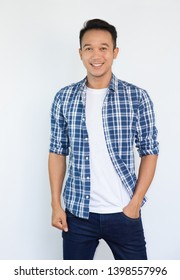 Attractive smiling young asian man with blue Casual Shirt look confident and handsome.