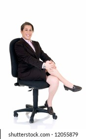 Attractive smiling young secretary on director chair. White background, studio shot.