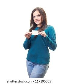 Attractive smiling young woman in a blue shirt holding a poster. Isolated on white background