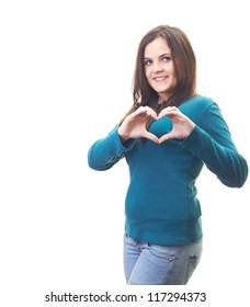 Attractive smiling young woman in a blue shirt with her hands showing symbol of heart. Isolated on white background