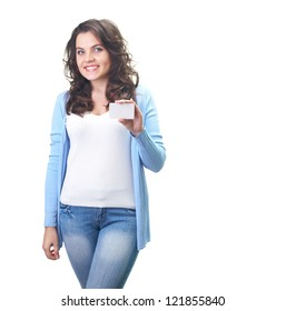 Attractive smiling young woman in a blue shirt holding in her left hand poster. Isolated on white background