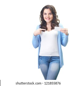 Attractive smiling young woman in a blue shirt holding in her left hand poster, and her right hand points to him. Isolated on white background