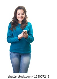 Attractive smiling young woman in a blue shirt holding mobile phone and looking at him. Isolated on white background