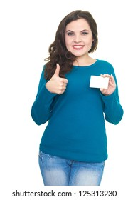 Attractive smiling young woman in a blue shirt holding in her left hand poster. Right hand showing thumbs up. Isolated on white background