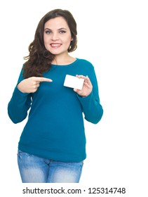 Attractive smiling young woman in a blue shirt holding in her left hand poster. The right hand points to the poster. Isolated on white background