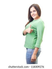 Attractive smiling young woman in a green shirt showing her right hand thumbs up. Isolated on white background