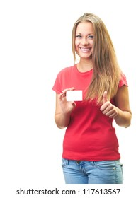Attractive smiling young woman in a red shirt holds a poster in her right hand and the left hand showing thumbs up. Isolated on white background