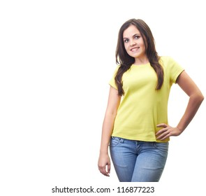 Attractive smiling young woman in a yellow shirt. Isolated on white background