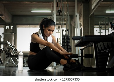 attractive sport asia woman workout with situp machine in sport gym