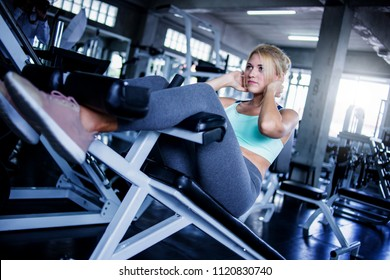 attractive sport caucasian woman workout with situp machine in sport gym health concept