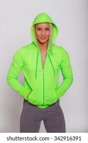 Attractive sporty female in green hoodie.