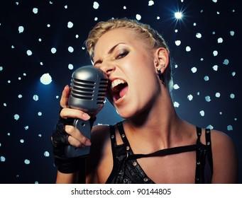 Attractive steampunk girl singing