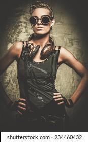 Attractive steampunk girl wearing googles