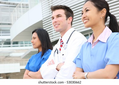 An attractive successful man and woman medical team outside hospital