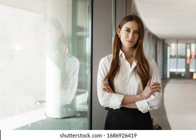 Attractive successful and strong female entrepreneur expressing confidence and power, cross hands over chest, looking camera, famous speaker prepare give lecture about woman in business