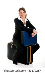 Attractive successful young female sales representative, traveler,  with briefcase and suitcase, studio shot.