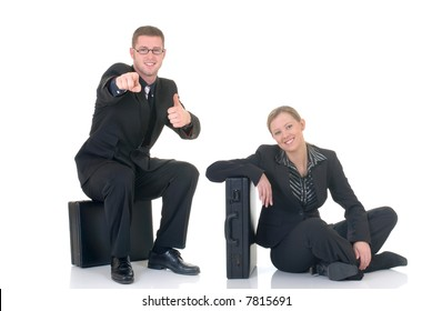 Attractive successful young smiling businesspeople with briefcase, happy expression.  studio shot.