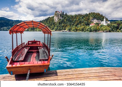 Attractive summer view of Lake Bled (Blejsko jezero) is a glacial lake in the Julian Alps in northwestern Slovenia. Sunny morning scene of Bled town and is overlooked by Bled Castle.