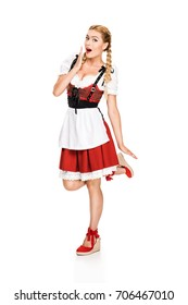 attractive surprised girl in traditional german costume, isolated on white
