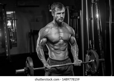 Attractive tall muscular bodybuilder doing heavy deadlifts