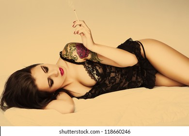 attractive tattoo pin up girl with cigarette