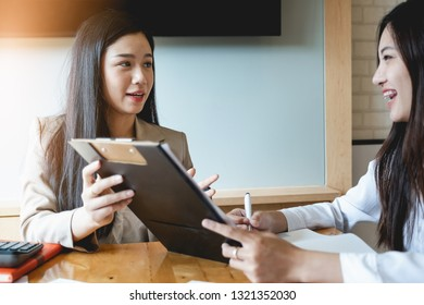 Attractive teamwork discuss and analysis data document in co-working space.