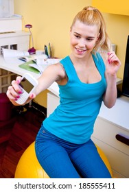 attractive teen girl making selfie with mobile phone in her room