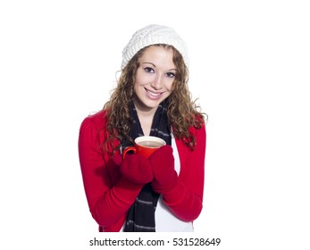 Attractive teen girl wearing sweater and mittens drinking hot tea. Image shot in studio isolated on white background