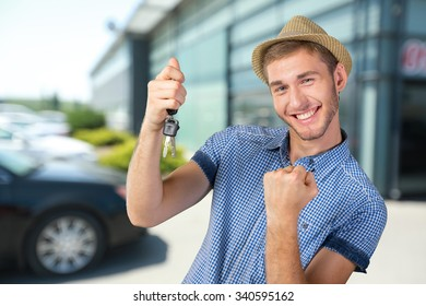 Attractive teenage boy holding car keys