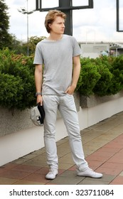 Attractive teenage boy in urban background